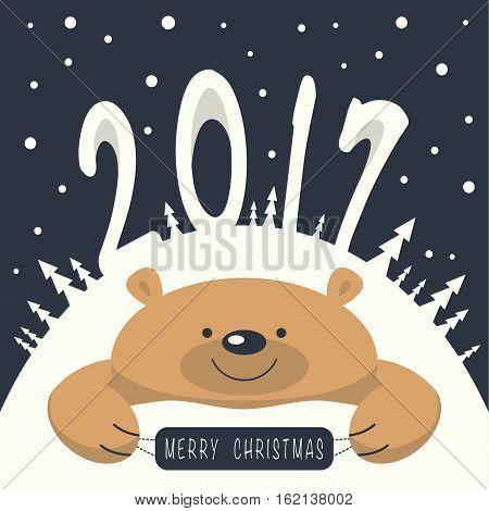 Christmas card. Brown bear lies on a snowdrift . On the mountain the numbers 2,0,1,7. It's snowing. Brown bear holds a plate with the phrase merry christmas on it.