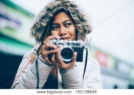 Freelancer asian photographer in a winter coat