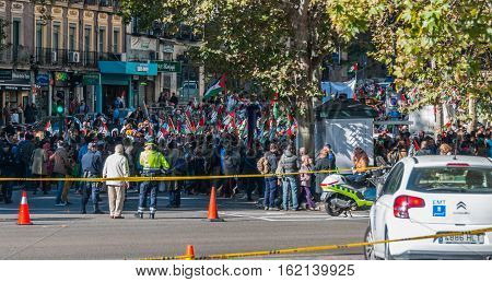 Madrid, Spain - November 9th, 2013:    Country's capitol on a warm November day - police monitor as people demonstrate peacefully in support of Western Sahara's independence from Morocco.