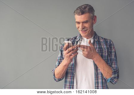 Mature Man With Gadget