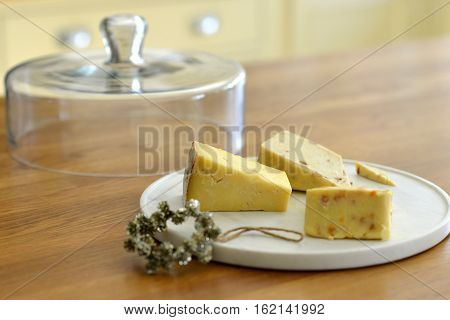 Covered marble Cheese plate with three cheeses