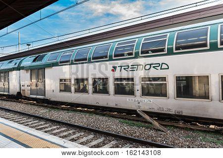 BERGAMO, ITALY - DECEMBER 2016: Train of the local Italian company Trenord at station of Bergamo town.