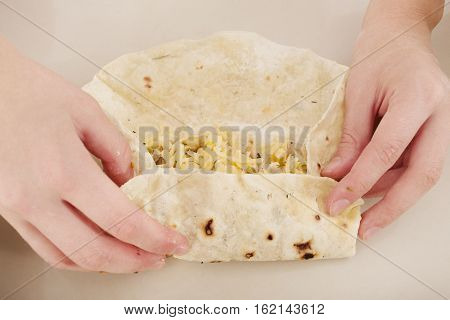 preparation of the homemade fajita, shawarma or tortilla, toned image
