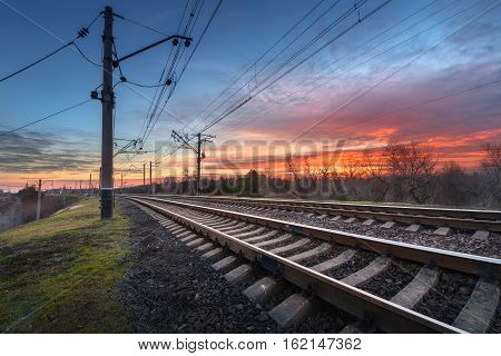 Railway Station Against Beautiful Sky At Sunset. Railroad
