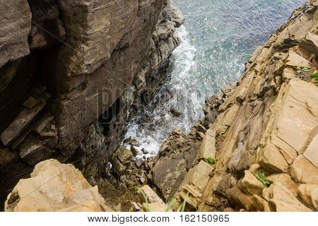 blue sky, high cliffs, the waves of the sea