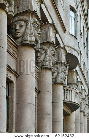 Architectural columns, windows with balcony in St. Petersburg and decorated with Egyptian sculptures