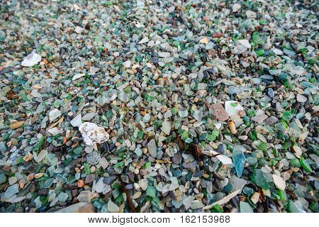 Close up of sea glass, 'sand' on Kauai's Glass Beach by Port Allen , Eleele . Broken glass bottles that have been tumbled in the waves for a long time, make up a significant portion of the sand.