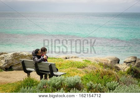 Traveler couple relaxing meditation with serene view seascape of Cape Leeuwin along the Indian Ocean Augusta Western Australia .