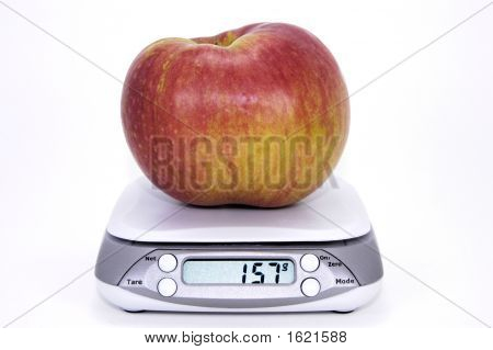 Apple On Scale With Metric Display