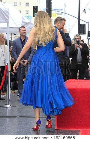 LOS ANGELES - DEC 15: Blake Lively at a ceremony as Ryan Reynolds is honored with a star on the Hollywood Walk of Fame on December 15, 2016 in Los Angeles, California