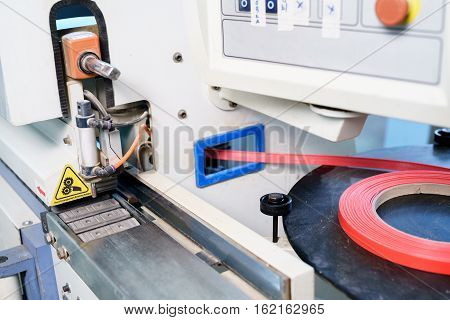 Furniture factory. Edge banding machine in the production of furniture, nobody