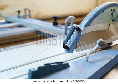Furniture factory equipment for chipboard edge production, nobody, selective focus