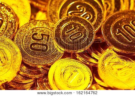 Golden coins piled in a heap of background.Gold reserves.Success and Wealth.