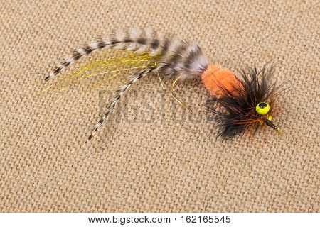 Colorful Fishing Fly on Burlap Close Up
