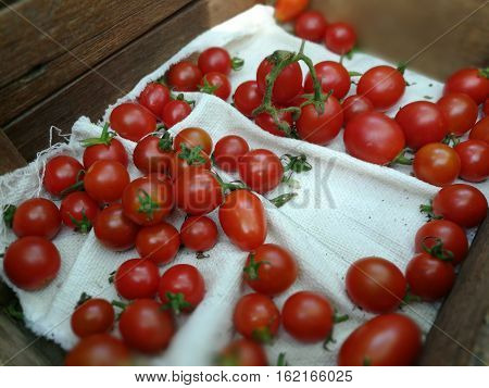 Delicious red tomatoes.A pile of tomatoes.Fresh tomatoes. all tomatoes in the box.