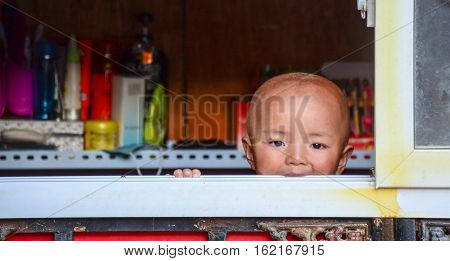 Tibetan Child At Home