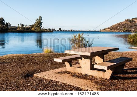 Picnic table overlooking Lake Murray reservoir in San Diego, California.