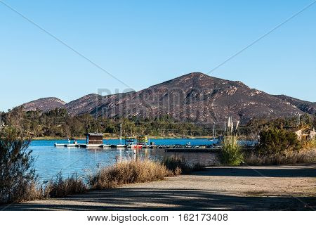 Boat rental dock with Cowles mountain at Lake Murray in San Diego, California.