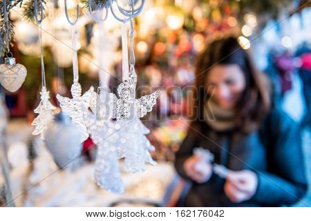 Beautiful girl shopping for Christmas decorations