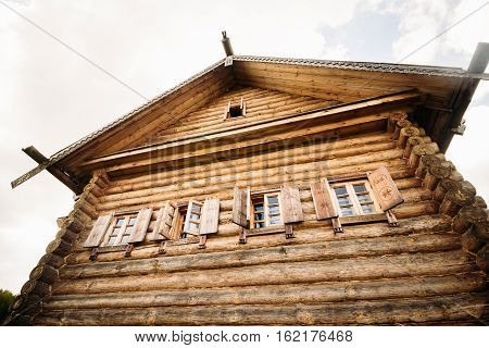 Wooden hut Slavic type against a gray sky.