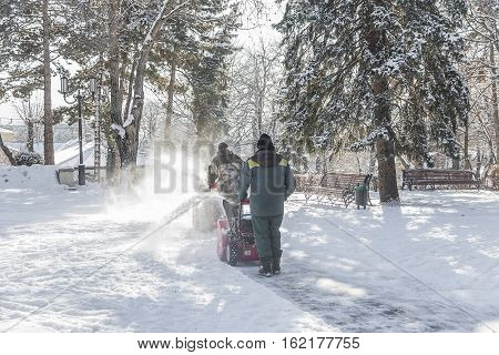 Snow Removal In The City Park.