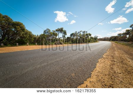 Long and endless Asphalt road in Walpole Australia.