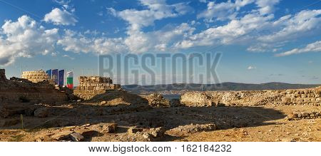 Nesebar Bulgaria - September 06 2013: Ruins and the remains of an ancient fortress wall in the old town of Nessebar on the Black Sea coast. UNESCO world heritage site. Panoramic shot.