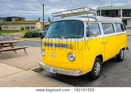 Adelaide Australia - August 14 2016: Classic yellow Volkswagen Transporter camper van parked on a street at Middleton beachfront