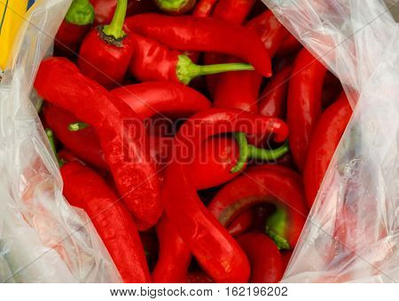 Polyethylene bag with red chili peppers, closeup