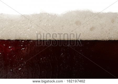 Dark beer bubbles closeup