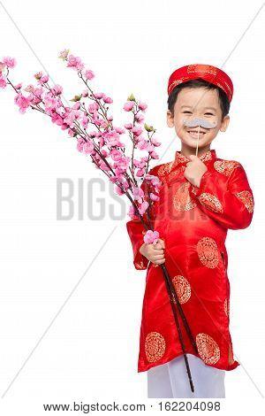 Funny boy wearing traditional costume Ao Dai celebrating Tet holiday