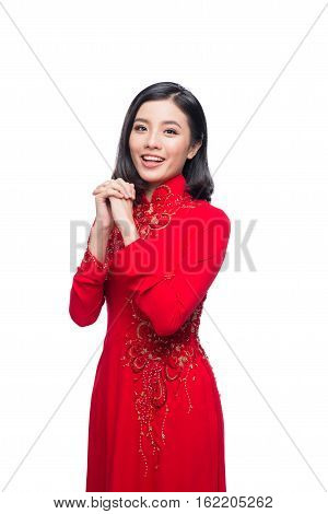 Portrait Of A Beautiful Asian Woman On Traditional Festival Costume Ao Dai. Tet Holiday. Lunar New Y