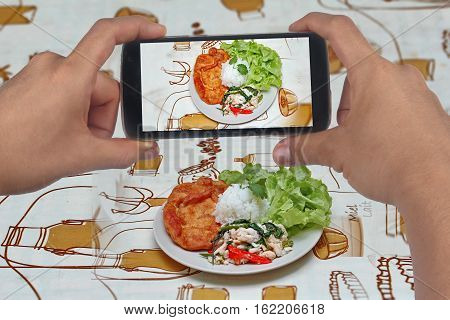 Take Photo ,rice Topped With Stirred Crab With Basil Leaf.