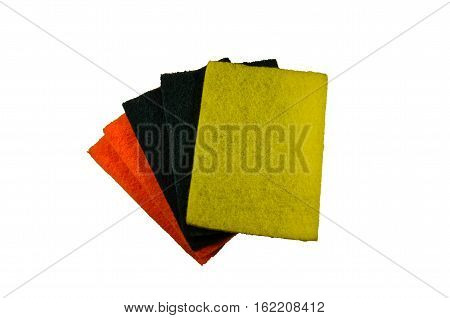 Multicolored kitchen sponges on the white background