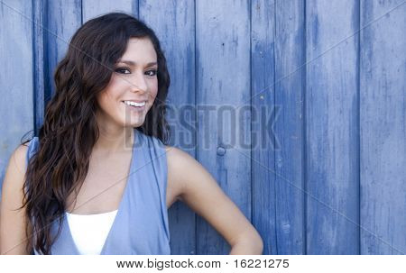 Smiling pretty woman in sporty clothing having fun and portraying a positive healthy lifestyle.