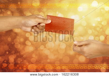People Hand Giving Red Envelope