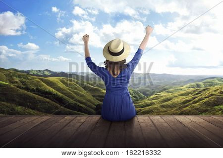 Back View Of Asian Woman Enjoying Panorama Of The Mountains