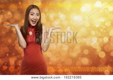 Chinese Woman In Cheongsam Dress With Happy Expression