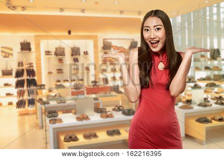 Asian Woman In Cheongsam Dress With Happy Expression