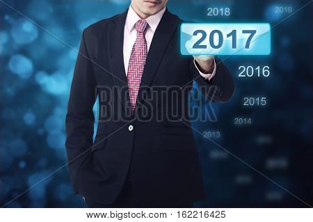 Businessman Hand Touching 2017 Button Number
