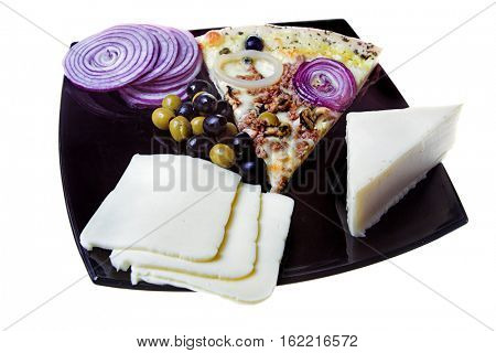 pizza and ingredients on black plate