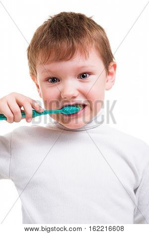 Boy without two baby teeth with toothbrush isolated on white background
