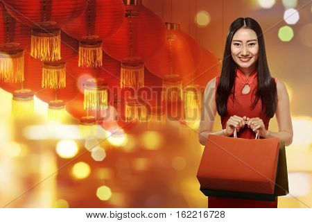Chinese Woman In Cheongsam Dress With Shopping Bag