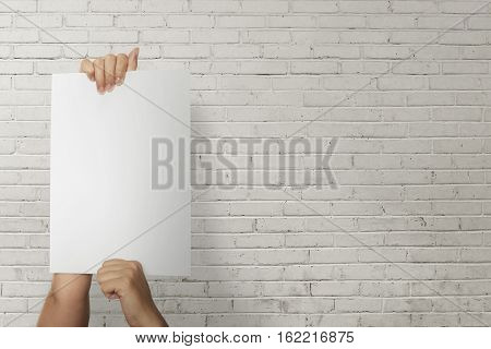 Person Hand Holding Paper Blank For Copyspace