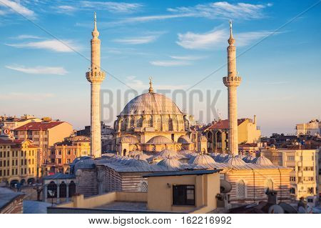 ISTANBUL - APRIL 16 2015: Laleli Mosque also called Tulip Mosque Turkish: Laleli Camii baroque style architecture Ottoman imperial mosque built by Sultan Mustafa III from 1760 to 1763. In sunset time