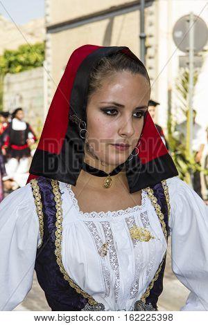 SELARGIUS, ITALY - September 9, 2012: Former marriage Selargino - Sardinia - portrayed a beautiful girl in traditional Sardinian costume