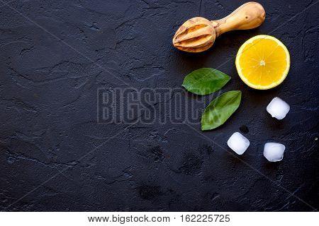 freshly squeezed orange juice on dark background top view.
