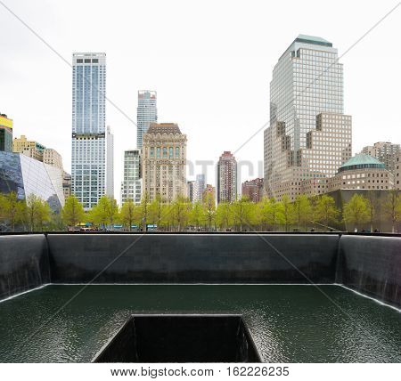 NEW YORK - APRIL 27 2016: Ground zero memorial water basin in manhattan