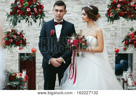 Bride Look Dreamy At The Fiance Among The Red Bouquets