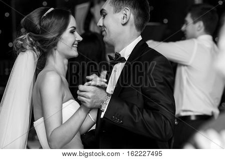 Just married laugh while dancing on the wedding